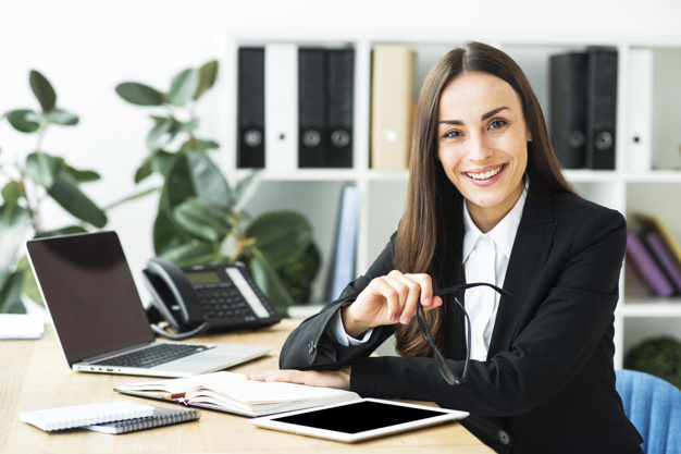 confident-happy-young-businesswoman-sitting-office-desk_23-2147943726